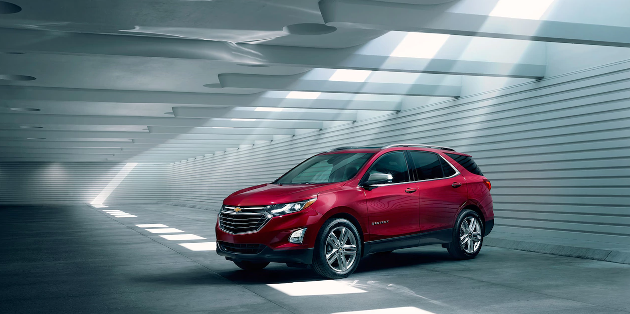 Red chevy equinox in a garage